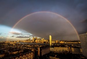 08 Dec 2015, London, England, UK --- London, United Kingdom. 8th December 2015 -- A massive rainbow breaks after an evening rainstorm over the River Thames and Canary Wharf business park buildings in London. -- A massive rainbow briefly broke over central London after an evening rainstorm. --- Image by © Guy Corbishley/Demotix/Corbis